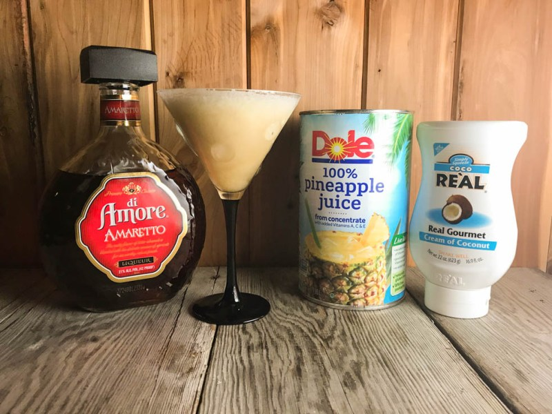 Break out the blender and make this Amaretto Pina Colada for a taste of the beach any time of the year. The blended goodness of pineapple juice, cream of coconut and rum topped with a shot a Amaretto just shouts sunshine and fun.