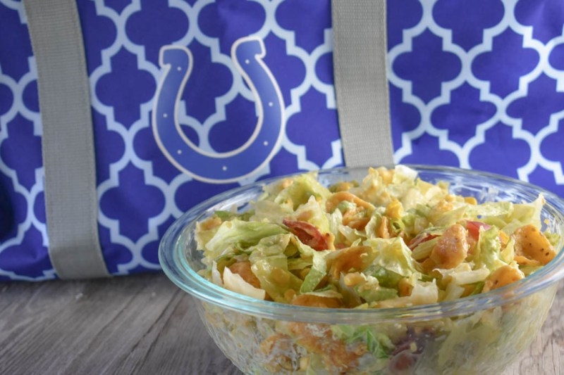 Cheesy Frito Salad is a great side dish option featuring corn chips, Velveeta and avocados.