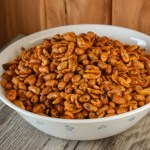 Using three ingredients - butter peanuts and chili seasoning, these Crock Pot Chili Nuts are a snack you won't be able to stop eating.