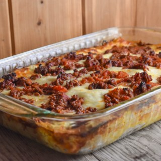 You can use ricotta cheese or cottage cheese (or a combination of both) to make this cheesy beef lasagna that holds together as you dish it out.