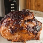 This Instant Pot Cranberry Glazed Ham recipe is so simple that it only has three ingredients, a ham, canned cranberry sauce and brown sugar.