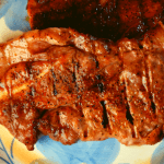 Grilled pork shoulder steaks will be a new go-to recipe for your summer grilling rotation. Simply let the steak marinate in a dry rub of garlic salt, paprika, brown sugar, and black pepper for 15 minutes, and grill. The result is a tender, pork steak full of flavor that the whole family will enjoy.
