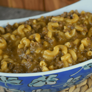 Frisco Melt Hamburger Helper is all the flavors of a classic Steak 'n Shake Frisco melt burger in the form of a quick, weeknight pasta.  The ingredients are simple---ground beef, macaroni, thousand island and french dressings, ketchup, Worcestershire sauce, Swiss cheese and Velveeta.  When combined into a homemade version of hamburger helper, your mouth will rejoice and your family will applaud.