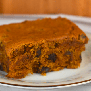 Vintage Spiced Pumpkin Cake is a simple recipe to follow that is big on flavor---featuring cinnamon and ground cloves.  The addition of raisins gives this pumpkin spice cake a perfect moist texture.  Serve with coffee for breakfast or add a cream cheese icing for an easy dessert option.