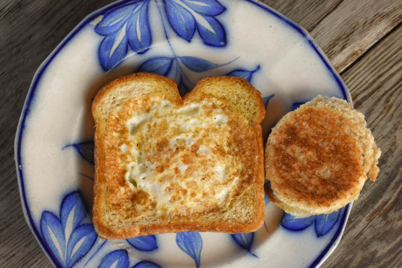 Egg in a Basket is a simple, yet delicious breakfast dish that you can have on the table in less than 10 minutes. A variation of the classic British dish - toad in the hole - this one features just toast and a runny fried egg.