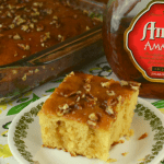 Amaretto Poke Cake isn't just for Amaretto lovers. It's a moist cake that pairs great with coffee for breakfast or makes the most delicious dessert for all ages. It features a decadent Amaretto glaze that is poured over an amped up box caked mix.