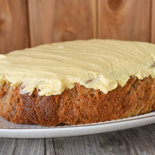 This Slow Cooker Hummingbird Cake is full of flavor, including banana, pineapple and cinnamon, and is topped with an easy buttercream frosting made with a box of pudding mix!