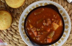 Hamburger Vegetable Soup with V8 Juice is the perfect meal for hungry kids and adults. With 5 simple ingredients, you can have a warm, hearty, family-pleasing soup on the table. Using a bottle of V8 and a bag of frozen vegetables makes this meal totally doable for a busy weeknight.