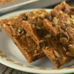 Crispy almond bars are an almond brittle that feature chocolate chips, almond extra and instant coffee powder for the perfect combination of flavors. Cut these into perfect bars or break into irregular brittle bites, and be sure to share with your friends and family.