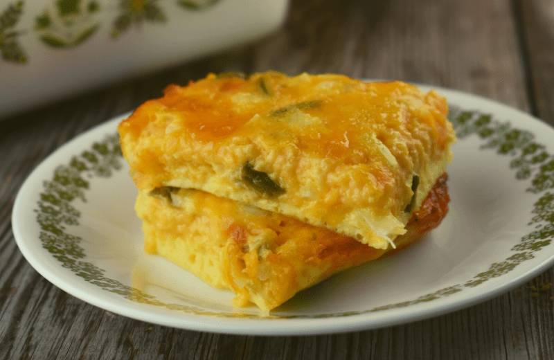 Cheesy Jalapeno Egg Squares are a simple 4 ingredient recipe made from eggs, shredded cheese, diced onion and canned, diced jalapeno peppers. This versatile Mexican egg casserole can be served for breakfast or cut into squares for a spicy appetizer.