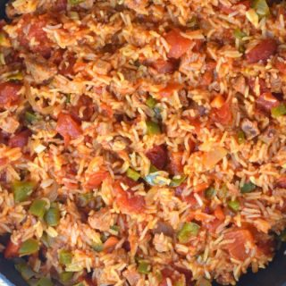 Jambalaya with Ham is the perfect leftover ham recipe after the holidays. This quick and easy jambalaya rice recipe is a one pan version that comes together in 30 minutes. This is a jambalaya recipe without shrimp.