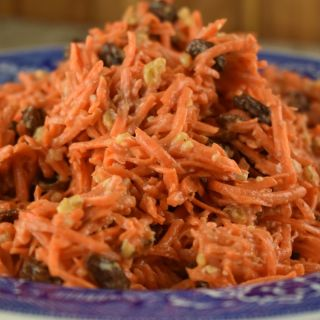 Looking for the perfect summer dish to pair with grilled steak or chicken? Carrot Raisin Salad combines sweet raisins and crunchy walnuts in a simple mayonnaise-based dressing. Make this ahead to let the flavors meld into sweet perfection.
