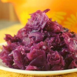 Don't wait until Oktoberfest to make this German-Style Red Cabbage. Braised in a skillet with green apples and a hint of cloves, this recipe is a hit with all ages.