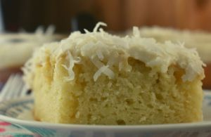 What makes this 9 x 13 Sour Cream Coconut Cake so special? This amped up white cake mix recipe has a dense, moist texture that comes from a combination of sour cream and cream of coconut. And the icing on the cake? Well, it's literally a homemade cream cheese frosting that is to die for.