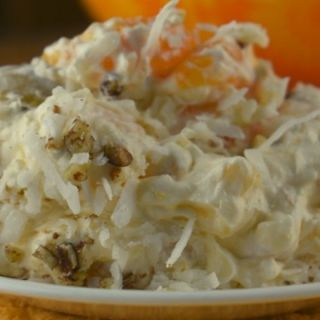 Lazy Daisy Salad is a classic 1950s Ambrosia fruit salad recipe with vanilla pudding, mandarin oranges and cool whip.