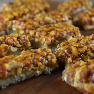 Looking for a recipe with mixed nuts? Ooey Gooey Mixed Nut Bars are a salty and sweet cookie bar that will satisfy both cravings.
