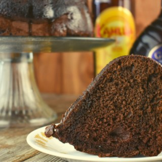 Chocolate Kahlua Bundt Cake is a light and airy double chocolate cake doused in a sweet, boozy glaze. It starts with a two shortcut ingredients, cake mix and pudding mix but is jazzed up with two types of booze, Kahlua and Crème de Cacao. Traditionally, this boozy chocolate cake is called a Black Russian Cake.