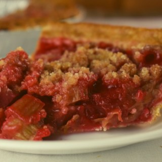 Rhubarb Pie with Strawberry Jello is an easy spring pie recipe. The classic flavors of strawberry and rhubarb come together in this tasty pie with a special crumble topping.