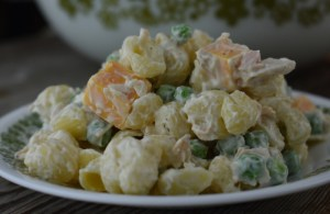 Tuna Pasta Salad is an Old Fashioned Macaroni Salad with Tuna that has frozen peas, albacore tuna and cheddar cheese cubes. It's simplicity can be deceiving since it packs a punch of flavor that is perfect for your summer dinner table.