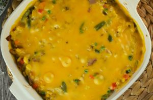 Cheesy Tuna Casserole is the perfect combination of elbow macaroni, mixed vegetables and Velveeta cheese. The only thing missing is cream soup. This version is a tuna casserole without canned soup, made from scratch.