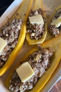 What can I make with yellow squash? Here's a solution to too many southern squash growing in the garden. Ground Beef Stuffed Squash is a Southern Stuffed Yellow Squash Recipe that is cheesy, beefy and delicious.