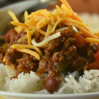 Weeknight Chili in a Skillet, a recipe for chili served over rice will satisfy the hunger of the whole family without hurting your wallet.