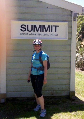 """Me standing by the """"Summit"""" sign."""