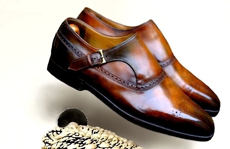 not sure of the maker, but patina done by Dandy Shoe Care