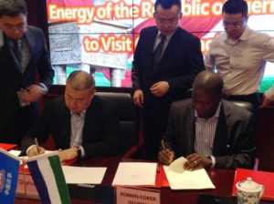 Robin Coker - Minister of Energy signs MOU