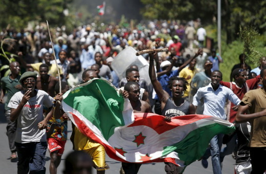 Protesters carry a Burundi flag during a protest against President Pierre Nkurunziza's decision to run for a third term in Bujumbura