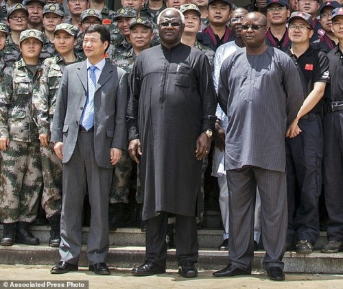 Sept. 25, 2014, Chinese Ambassador Zhao Yanbo, with  Sierra Leone's president Koroma - centre and  Vice President Sam-Sumana - right