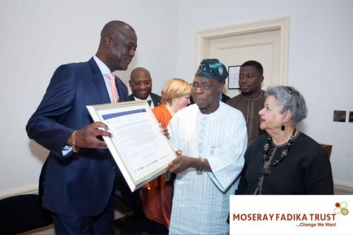 Fadika receiving an award from Obasanjo