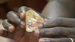 President Koroma holding the second largest diamond ever found in Sierra Leone