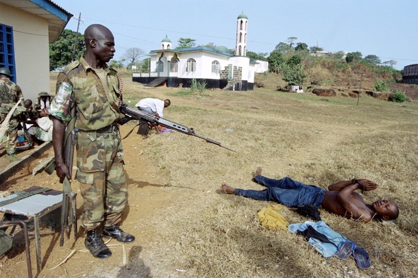 A Nigerian-led ECOMOG soldier watches a