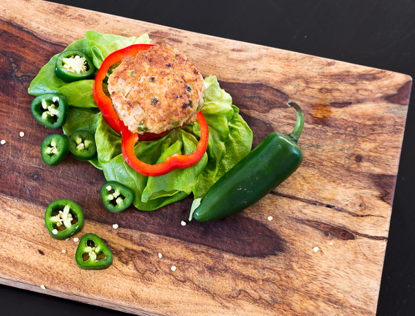Jalapeno Chicken Burger on wooden cutting board