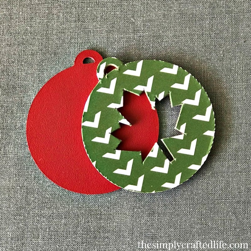 How to cut chipboard with Cricut Knife Blade and also how to use vinyl and iron on with chipboard. Create these leather and chipboard keychains, which make great, easy to personalize gifts.