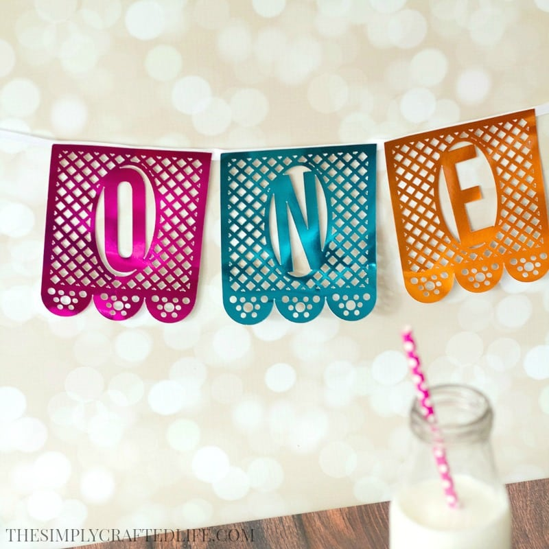 Learn how to make a papel picado banner using your cricut and SVG files from Fresh Cut - perfect for a fiesta themed birthday party!