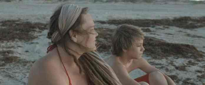 Daniel Blanchard as The Boy and Melissa McKinney as The Mother, by the sea.