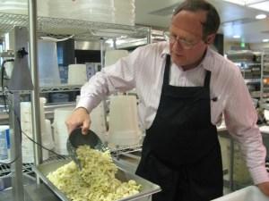 Me, in hair net, weighing pasta