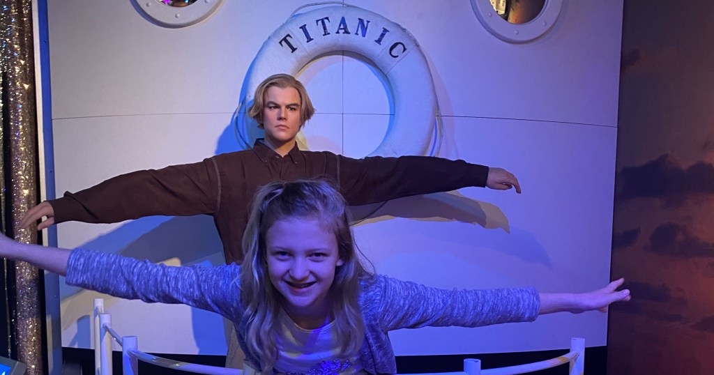 A child poses with a wax figure of Leonardo DiCaprio on board the Titanic
