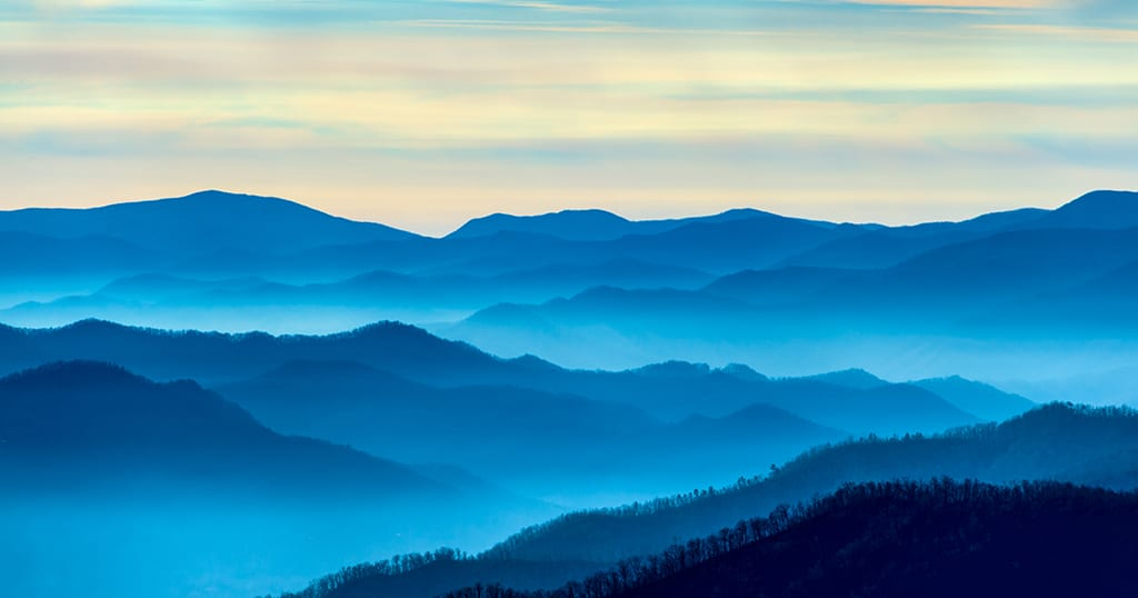 Blue smoke rises from the Smoky Mountains