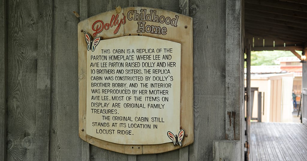 A sign outside Dolly Parton's childhood home replica at Dollywood