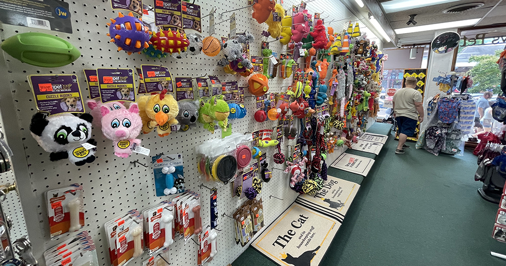 A wall of pet toys