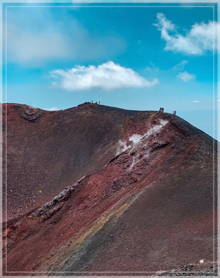 red volcanic sand and steaming landscape at Mount Etna crater