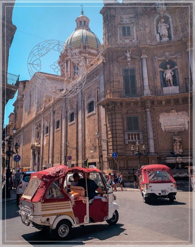 Tuk-tuks driving through Quattro Canti, the center of Palermo's old town