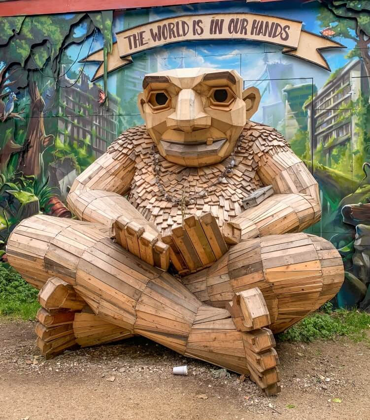 Troll sculpture made of scrap wood by Thomas Dambo located in Christiania, Copenhagen