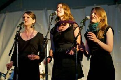 Backup vocalists with CR Avery at the Vancouver Folk Music Festival July 17 2011. Christopher Edmonstone photo