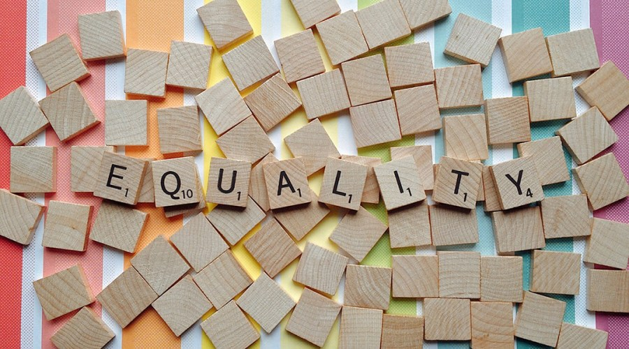 Equality photo illustration using Scrabble pieces.
