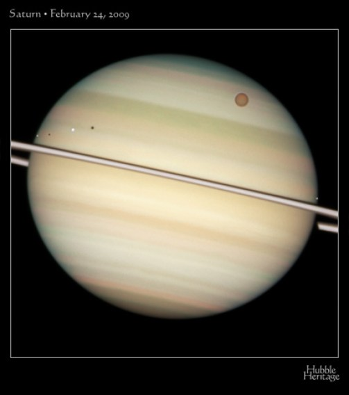 A Hubble Heritage view of the Saturn transit. (Click to embiggen.)