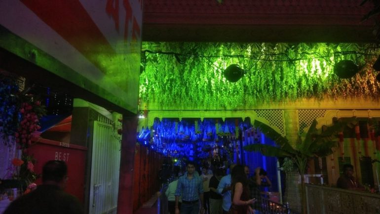 Hanuman Temple hallway lit with Green Light and Floral Decoration
